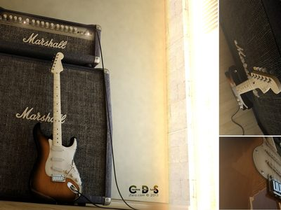 Fender Stratocaster and a Marshall Amp.